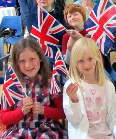 Younger spectators wave Union flags