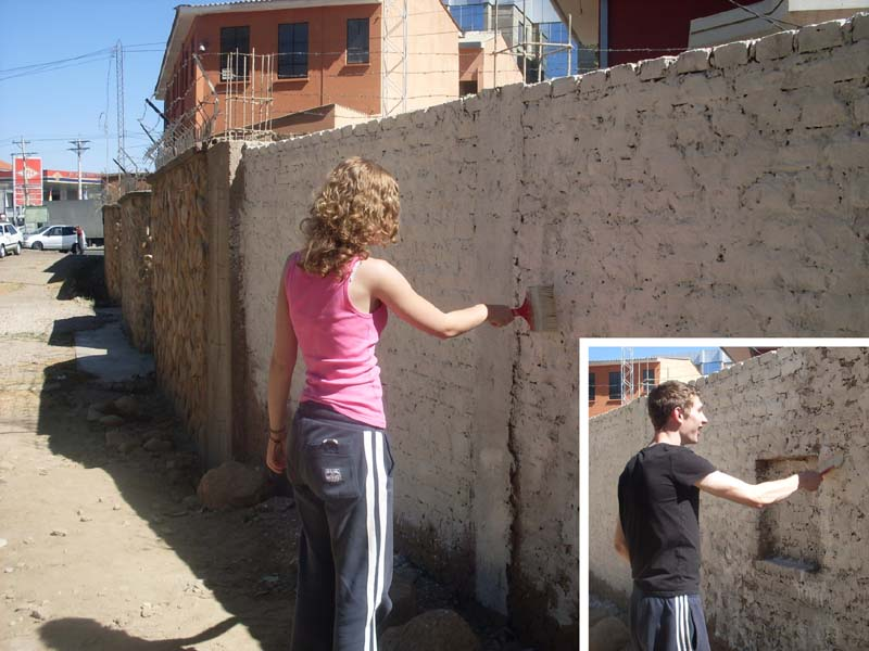 beccy and Dan painting a wall