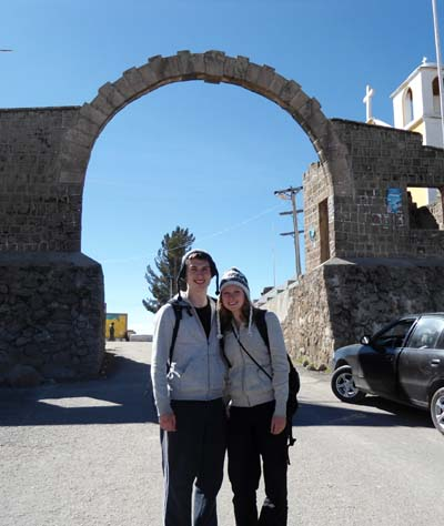 Dan and Beccy in front of a historic arch