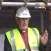 Bishop David lays the foundation stone of the new building