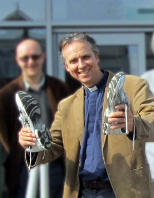Geoff Lanham holding a pair of running shoes