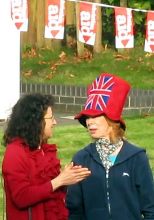 A woman wearing a Union Flag hat