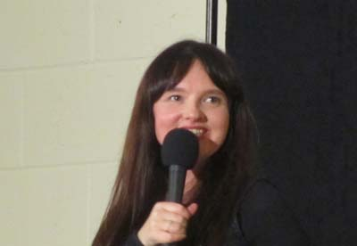Jo Enright with a microphone