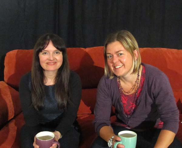 Jo Enright and Helen Tomblin on a settee