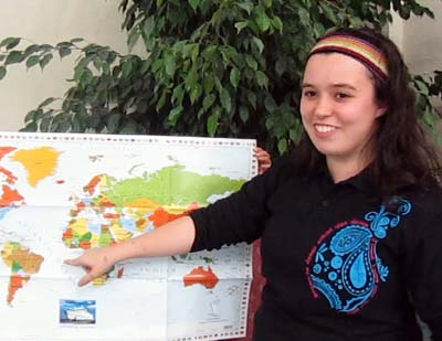 Natalie in front of a world map