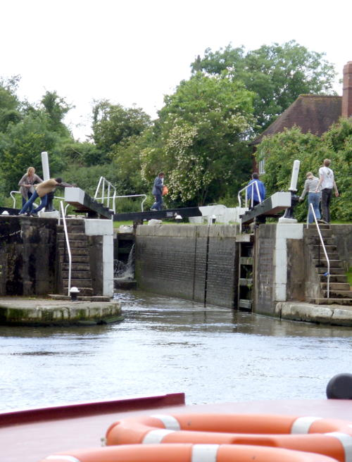 Working a lock on the Saltisford canal near Warwick