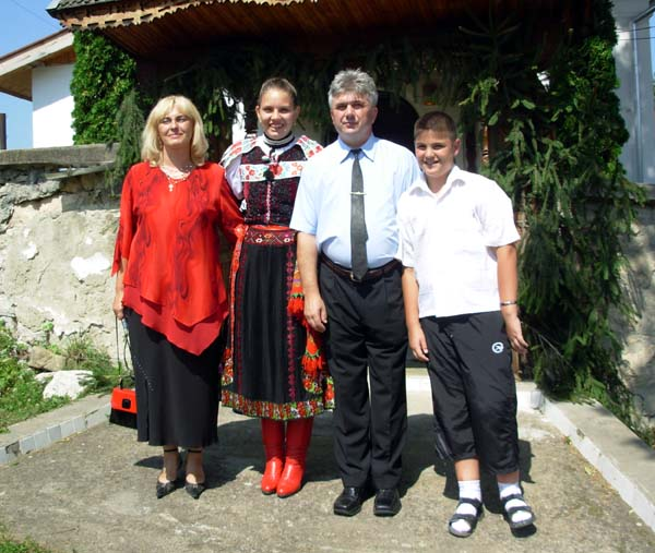 Melinda, Boglárka, István and Dávid by the entrance to their church