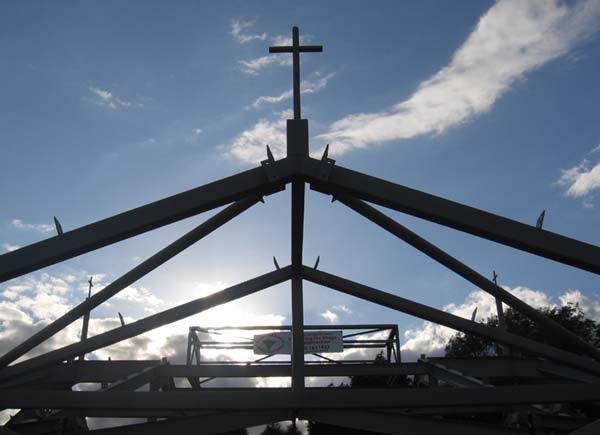 A framework of metal girders topped by a cross