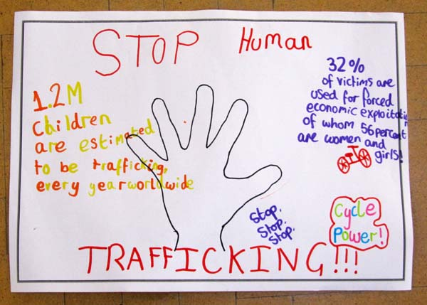 A hand-drawn poster highlighting some statistics concerning human trafficking