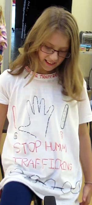 A cyclist wears a Stop Human Trafficking T-shirt