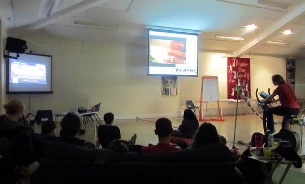 The Reloaded youth group watch a video about human trafficking in the darkened main hall