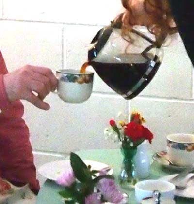 Pouring coffee into a china cup